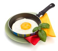 Fried egg on pan Stock Photos