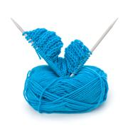 Woollen thread and knitting needle. needlework accessories. Stock Photos