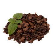 crushed chocolate shavings pile and mint leaf - stock photo