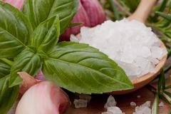 fresh herbs and salt spoon - stock photo