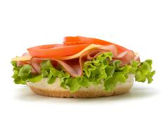 healthy open sandwich with lettuce, tomato, smoked ham and cheese - stock photo
