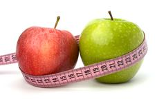 Apple with tape measure. healthy lifestyle concept. Stock Photos