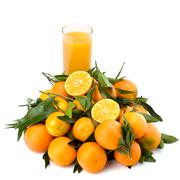 Stock Photo of tangerines and juice glass