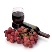Full red wine glass goblet, bottle and grapes Stock Photos
