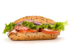 fast food baguette sandwich with lettuce, tomato, ham and cheese - stock photo