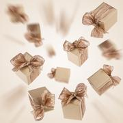 Flying gold gifts background Stock Photos