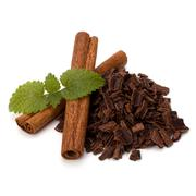 crushed chocolate shavings pile and cinnamon sticks - stock photo