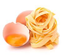 italian egg pasta fettuccine nest - stock photo