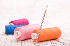 Spool of thread and needle. sew accessories. Stock Photos