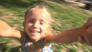 Stock Video Footage of Mother Spinning Child, Playing with Little Girl, Kid Smiling at Camera, Children