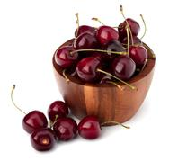 cherry in wooden bowl - stock photo