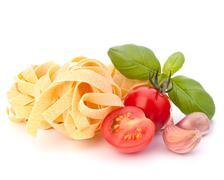 Italian pasta fettuccine nest  and cherry tomato Stock Photos