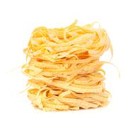 italian pasta tagliatelle nest isolated on white background - stock photo