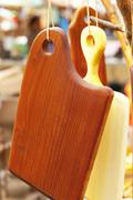 Chopping boards hanging on a rope Stock Photos
