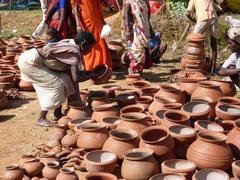 Stock Photo of tribal women buy clay pots