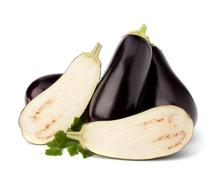 eggplant or aubergine and parsley leaf - stock photo