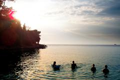 People Swimming in the Sea in Porec, Croatia - stock photo