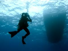 diver clearing mask while descending - stock photo