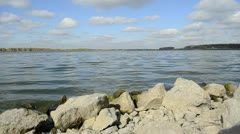 Lake with stony banks - stock footage