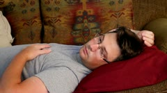 Depressed man laying on couch Stock Footage