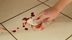 Cleaning up Blood From a Tile Floor - stock footage