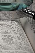 magnifer and dictionary - stock photo
