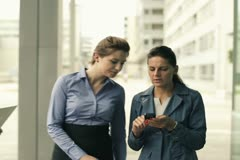 Young businesswomen with smartphone in the business park Stock Footage