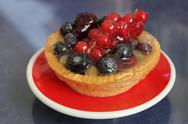 Red currants tartlet with red and black berries Stock Photos