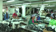 Stock Video Footage of Asian Garment Industry Factory: Slow pan around textile rolling room