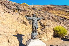 statue of jesus at the foot of mount teide - stock photo