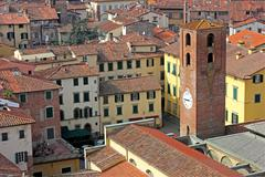 city view of lucca with the clock tower - stock photo