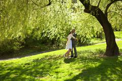 just married standing under the greenwood tree - stock photo