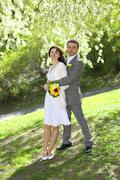 Just married standing under the greenwood tree Stock Photos
