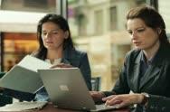 Two businesswomen working in cafe, steadycam shot Stock Footage