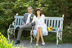 Just  married sitting on the bench Stock Photos