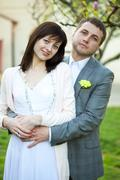 just  married in a beautiful garden - stock photo