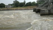 Spring flood water whirlpool flowing on hydroelectric power station dam Stock Footage