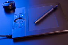 Drawing tablet in blue light Stock Photos