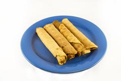 Stock Photo of wafer rolls on a plate isolated on white
