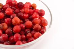 glass bowl with cranberries isolated on white - stock photo