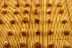 hazelnuts on a bamboo mat - stock photo