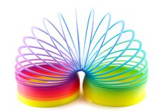 Stock Photo of colorful toy spring isolated on white