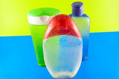 cosmetic containers on a colorful background - stock photo