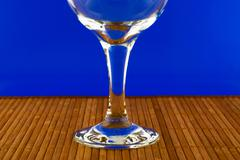 conceptually lighted wine glass on a multicolored background - stock photo