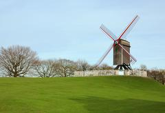 windmill in the park in bruges, belgium - stock photo