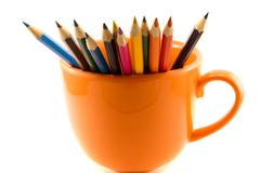 Cup with colored pencils isolated on white Stock Photos