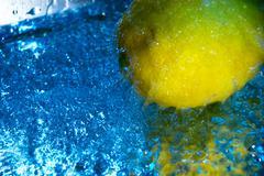 Lemon and water drops Stock Photos