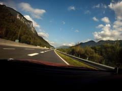 Highway in Austrian Alps - Point of View (POV) Driving Shot - stock photo