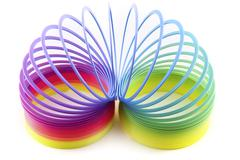 colorful toy spring isolated on white - stock photo