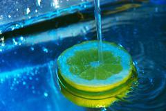 lemon under running water - stock photo